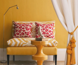 animal print pillow and chairs