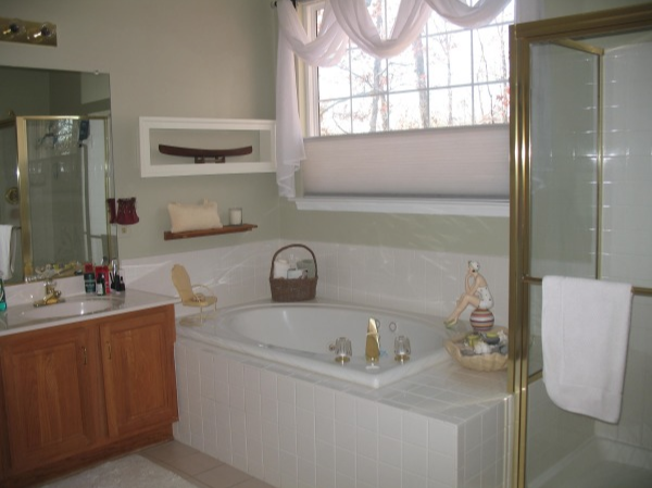 1990s Bathroom with shiny brass and oak.