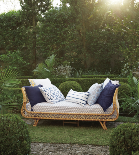 Rattan Daybed in yard with pillows